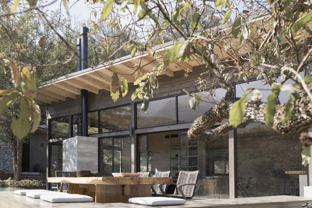 Large windows and sliding doors connect the social areas to a beautiful terrace