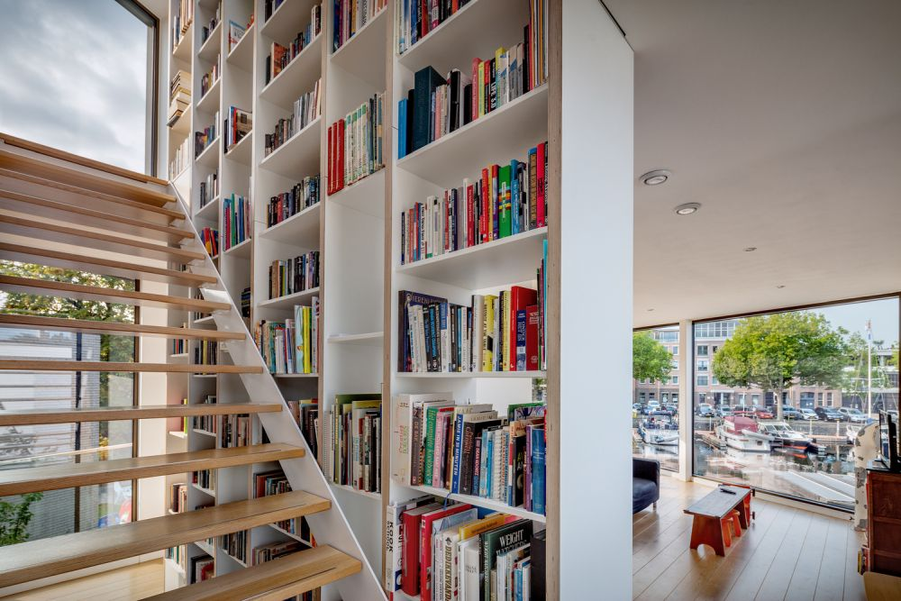 The triple-height bookcase and the staircase are combined into a hybrid structure