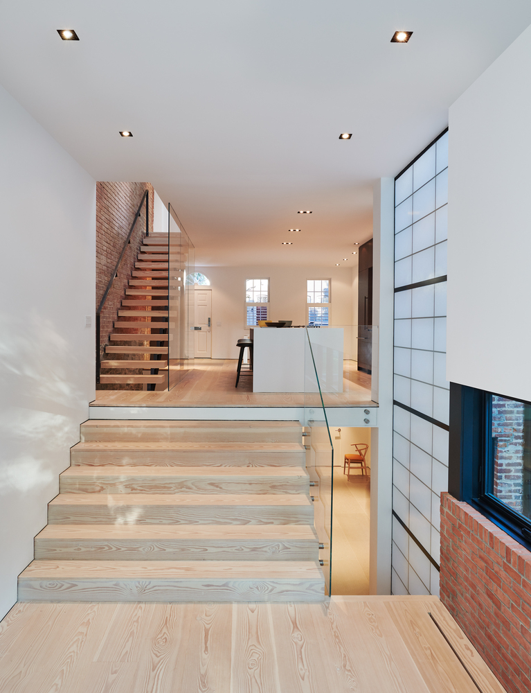 The light wooden floors and stairs adds lots of warmth to the interior design without standing out