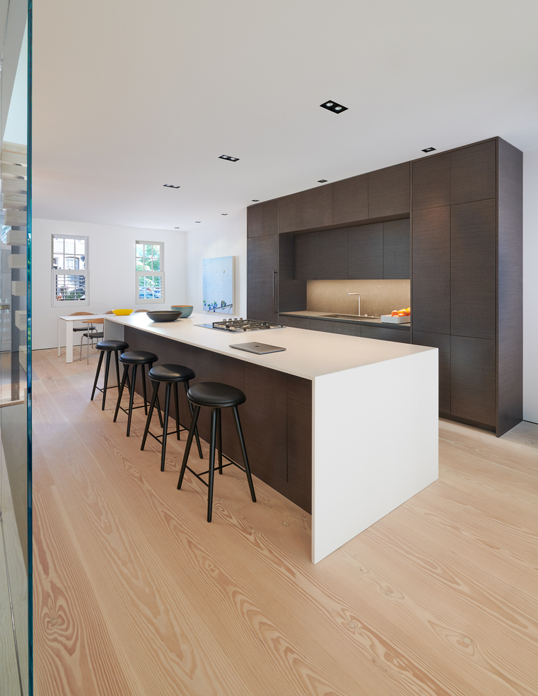 The kitchen got a makeover and is now super sleek, modern and refined