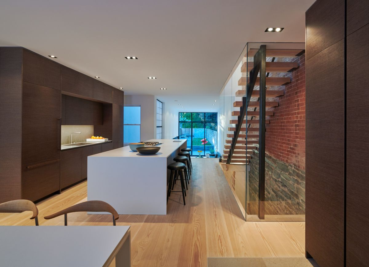 The interior of the existing house was renovated as well, getting taller ceilings and a simplified look