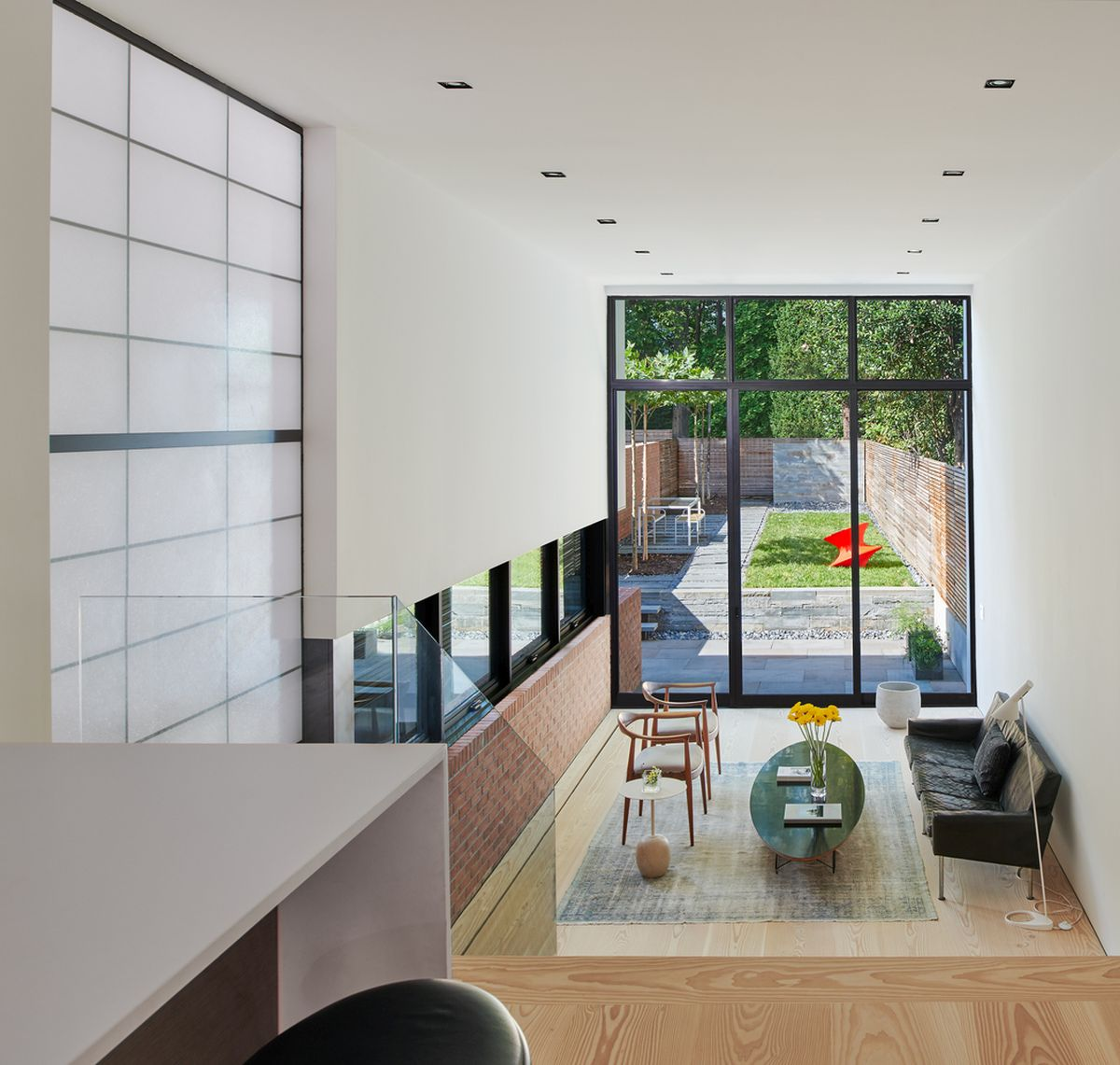 Even though the extension is very narrow, the two floors have high ceilings which helps them look bigger