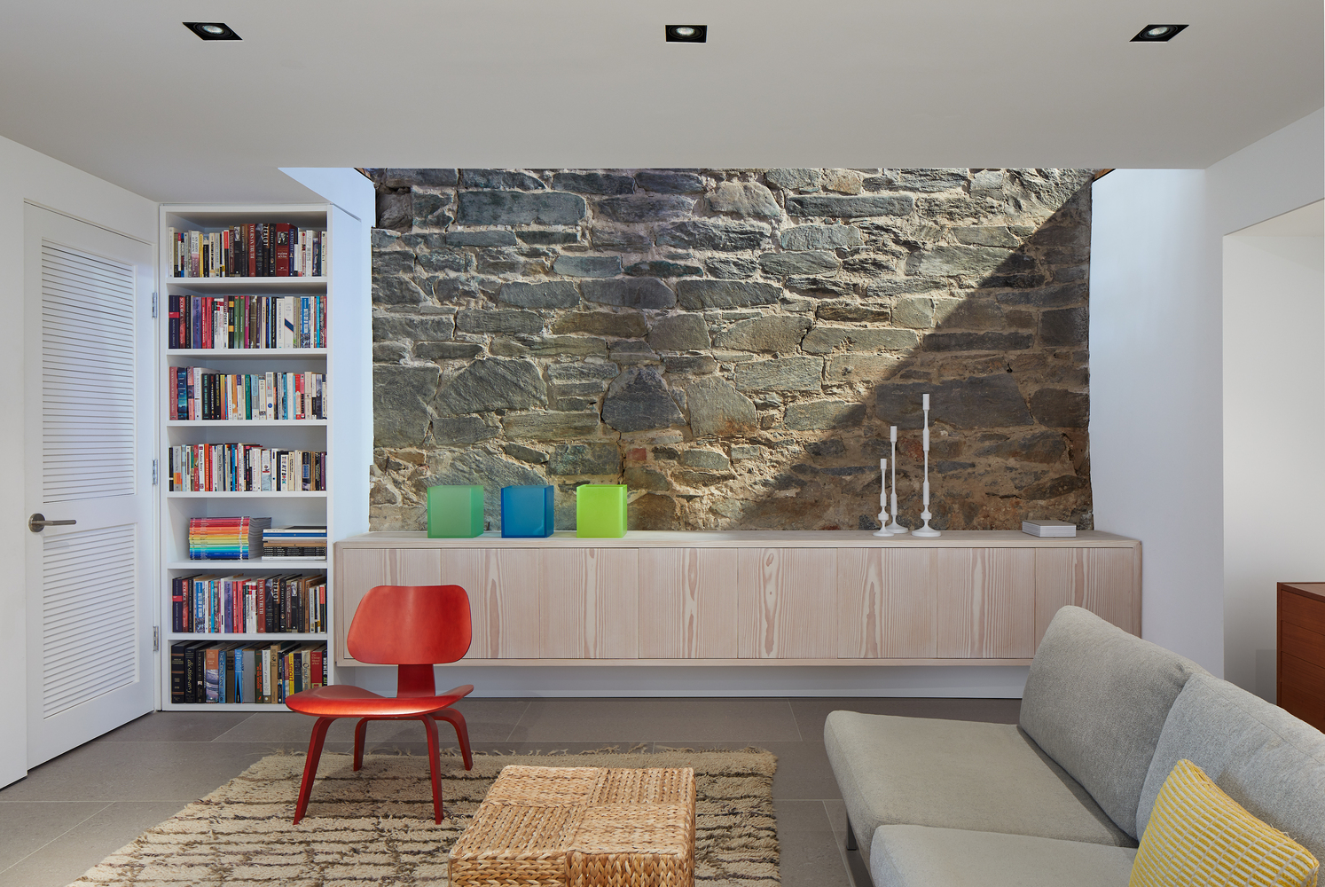 Exposed stone is used as an accent material throughout the house