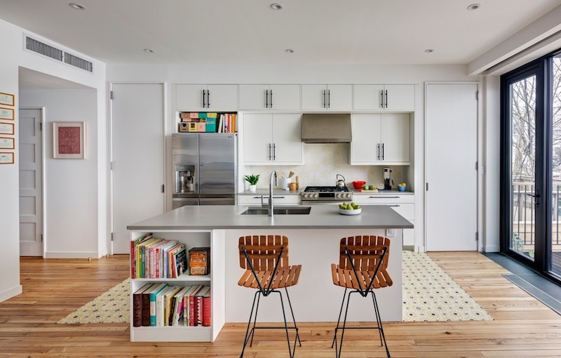 The kitchen is open as well and has sliding doors that connect it to the backyard