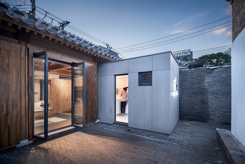 The concept house was built inside the frame of an existing structure, with a single small addition