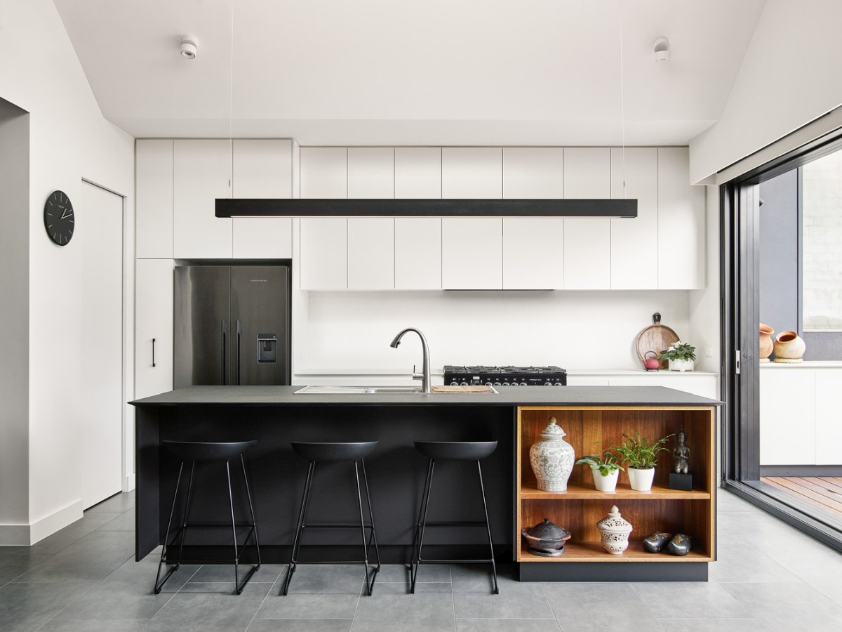 The kitchen has a very clean and bright look thanks to the white built-in cabinetry