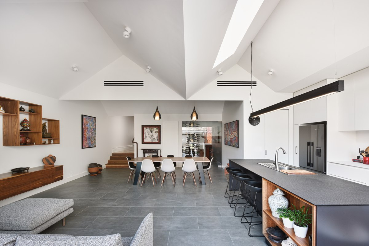 the new living area is a large open space which integrates the seating area, kitchen and the dining room
