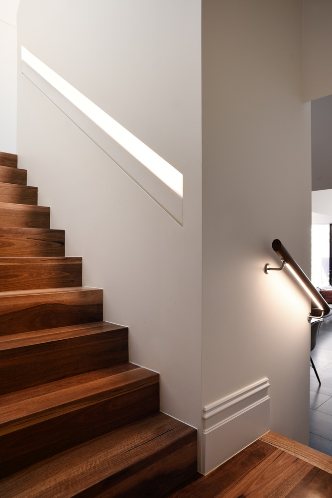 A wooden staircase leads up to the new areas which have been added