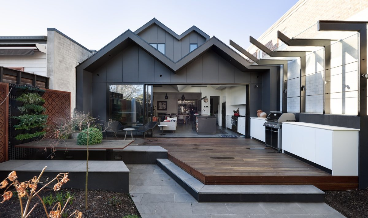 The back of the house mimics the front but in a modern style