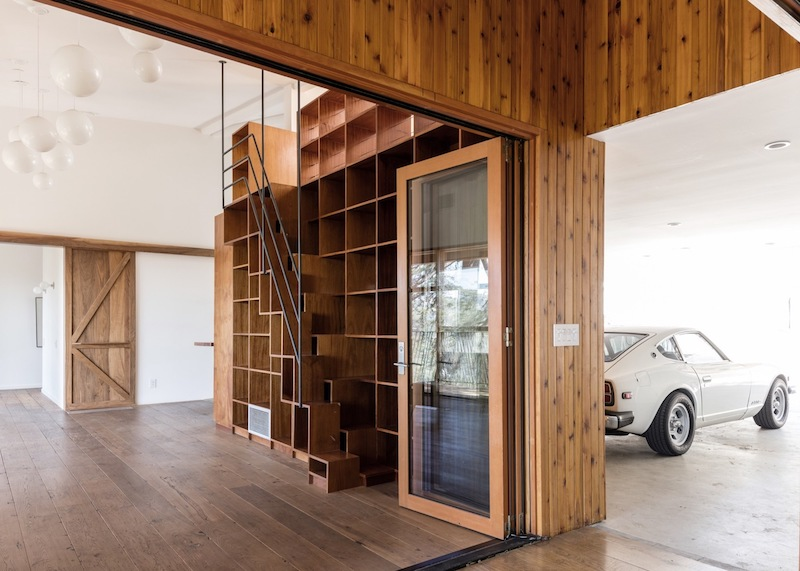 This staircase is cleverly disguised as bookshelves, serving a double purpose