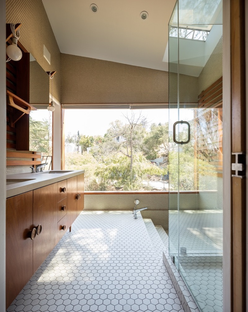 The bathrooms have surprisingly large windows which ensure a bright and open decor