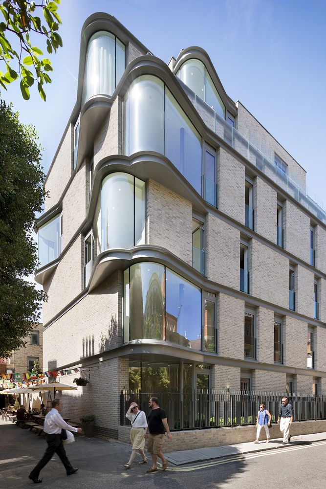 The curved windows also help to soften the edges of the building b wrapping around the corner