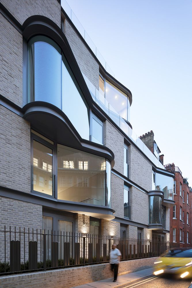 The protruding windows expose the apartments and townhouses to the surroundings
