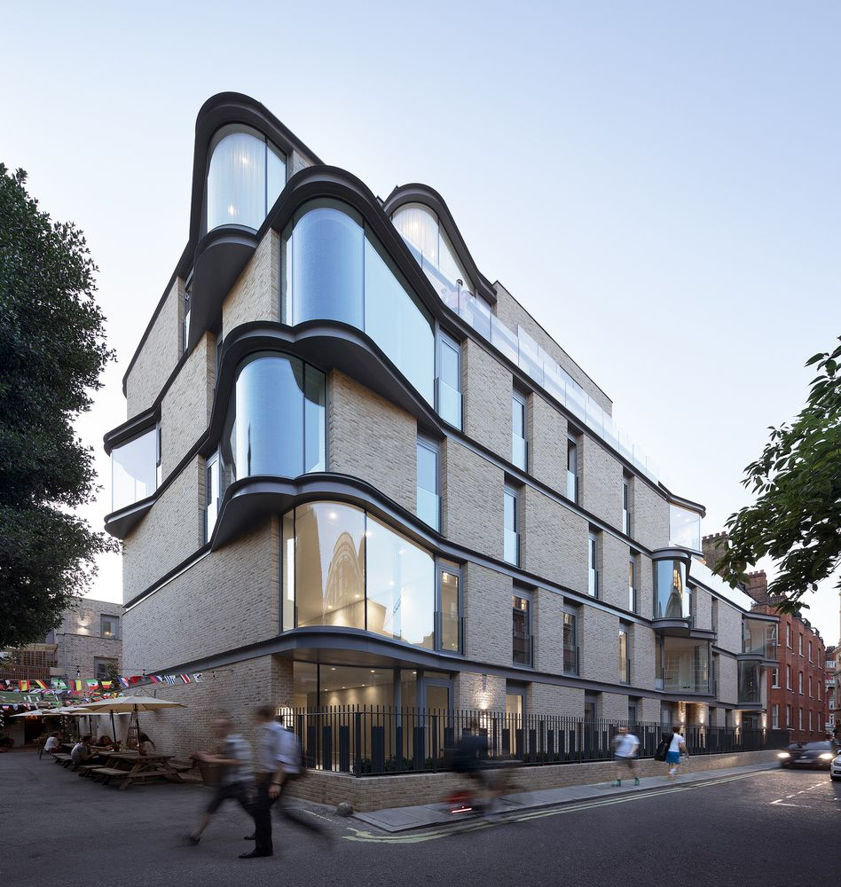 The building occupies a corner plot and is framed by two streets right along the sides