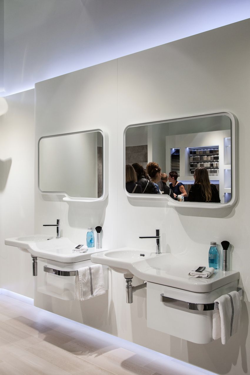 Modern and wall-set, this duet of individual vanities has a retro feel thanks to their shape and design.