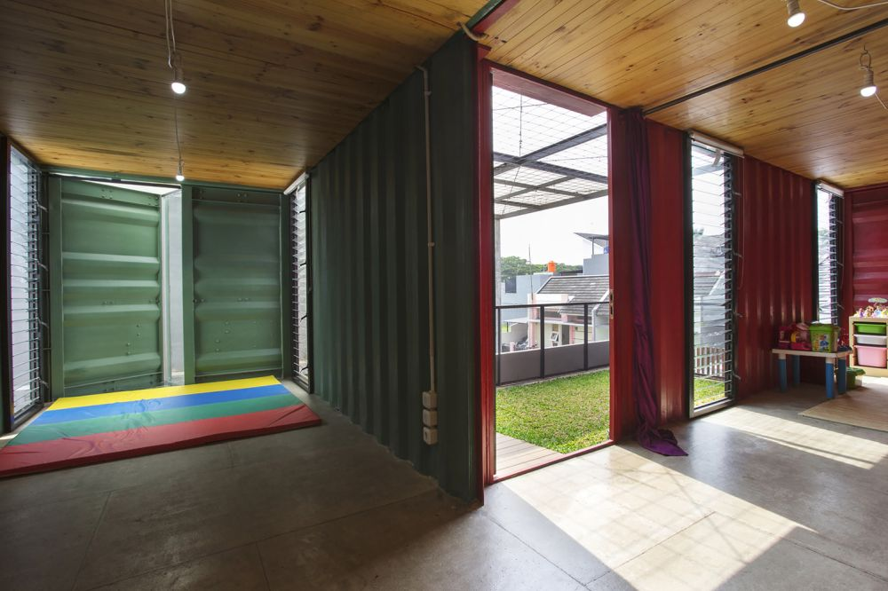 The polished concrete floors go really well with the metal container modules and they're complemented by warm wooden ceilings