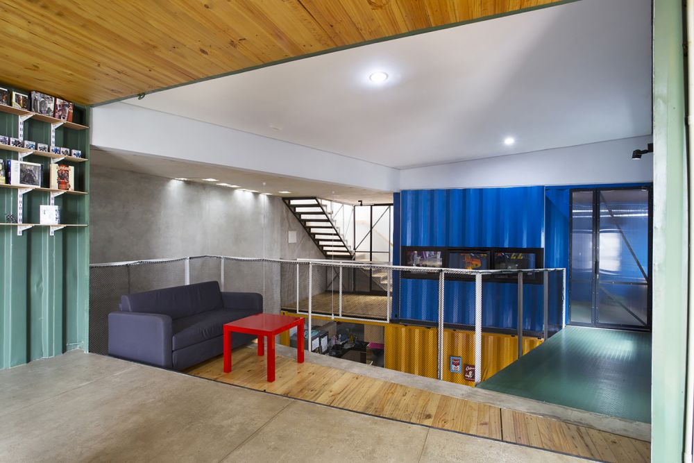 The containers intersect and overlap, creating different areas throughout the house
