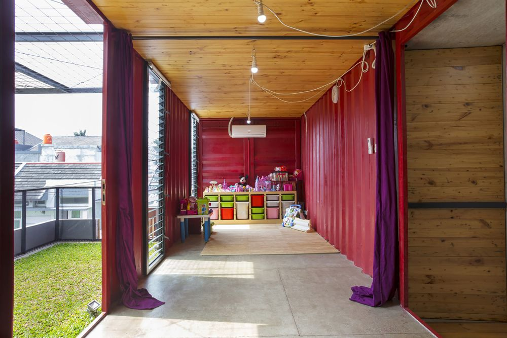 One of the containers serves as an activity room for the kids and the parents