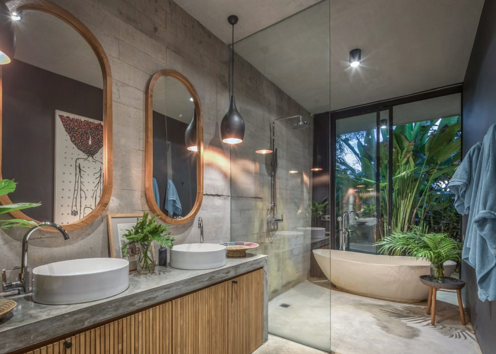 The master bathroom resembles a relaxing and inviting oasis infused with greenery