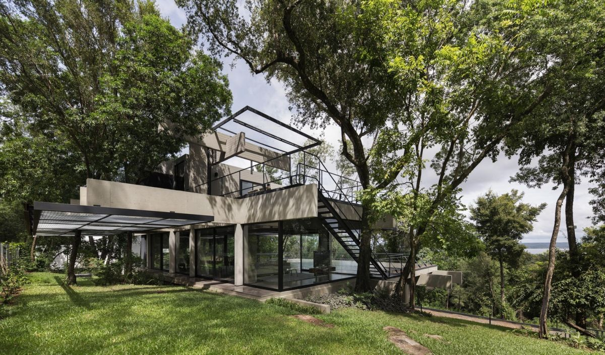 The raw concrete and exposed metal add texture to the house and its industrial aesthetic