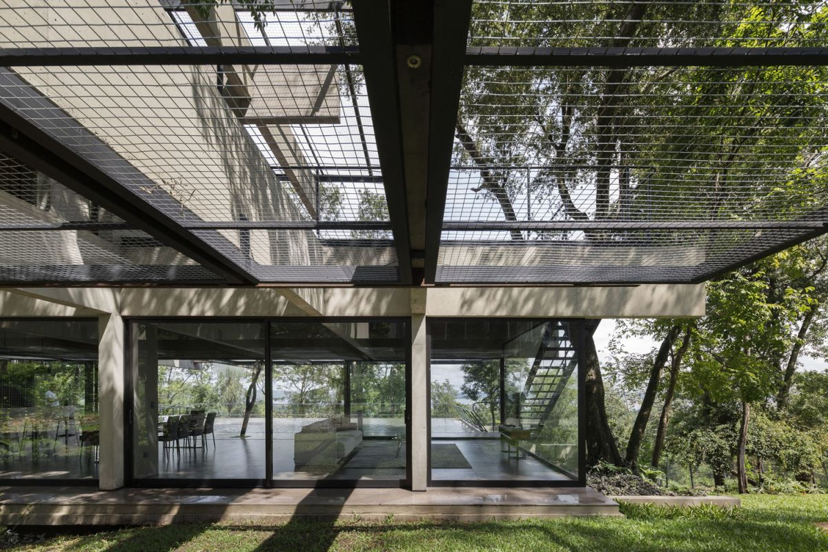 The indoor areas extend outside bringing the house closer to its surroundings