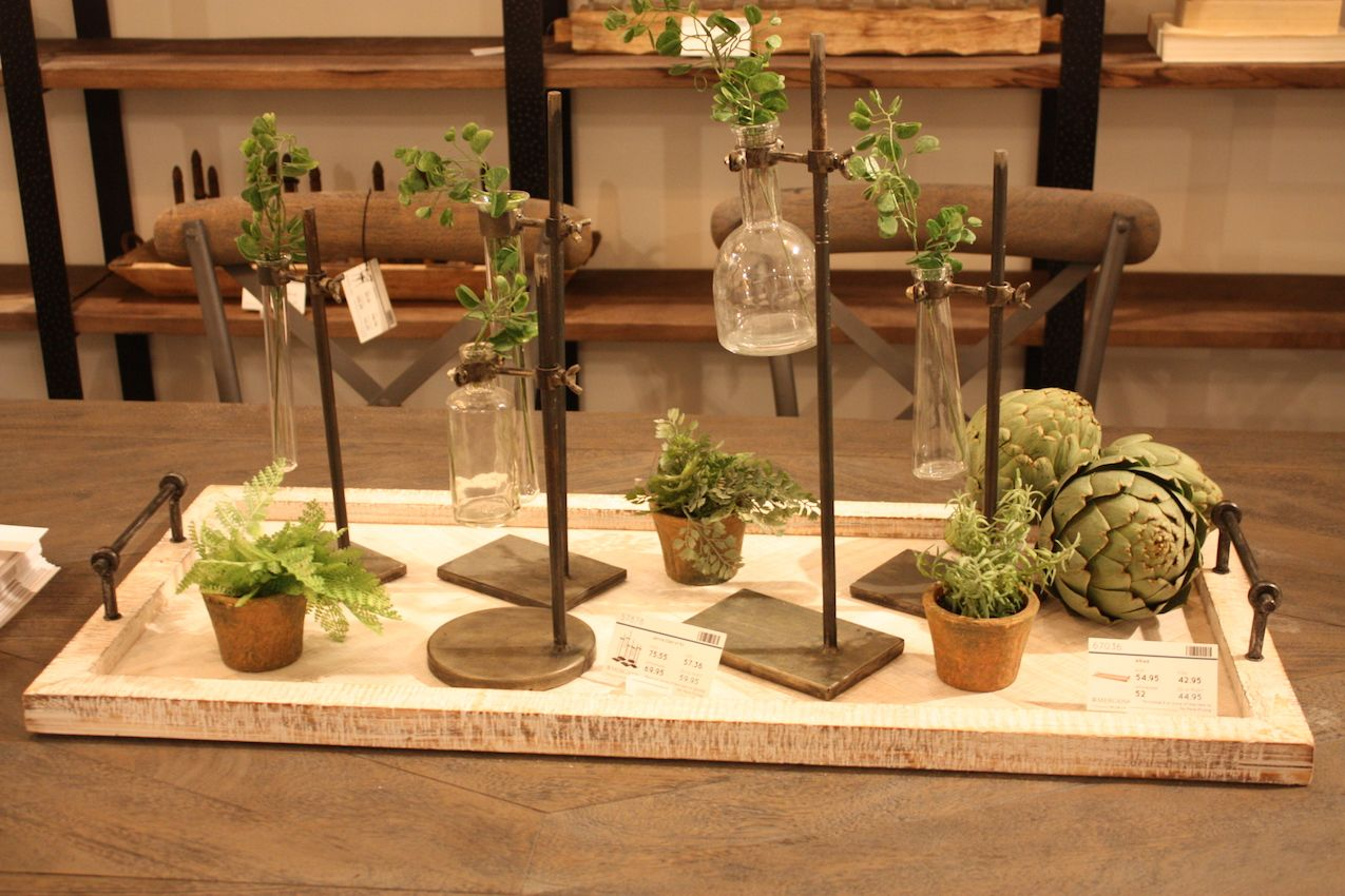Greenery is a great way to add a lighter touch to a heavy metal decor style.