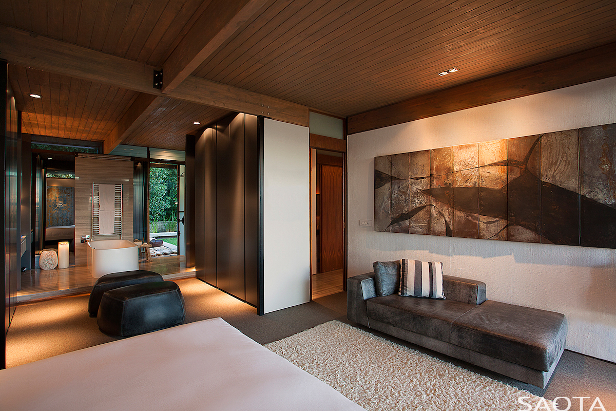 The main bedroom is now open to the adjacent bathroom and even has its own intimate lounge space