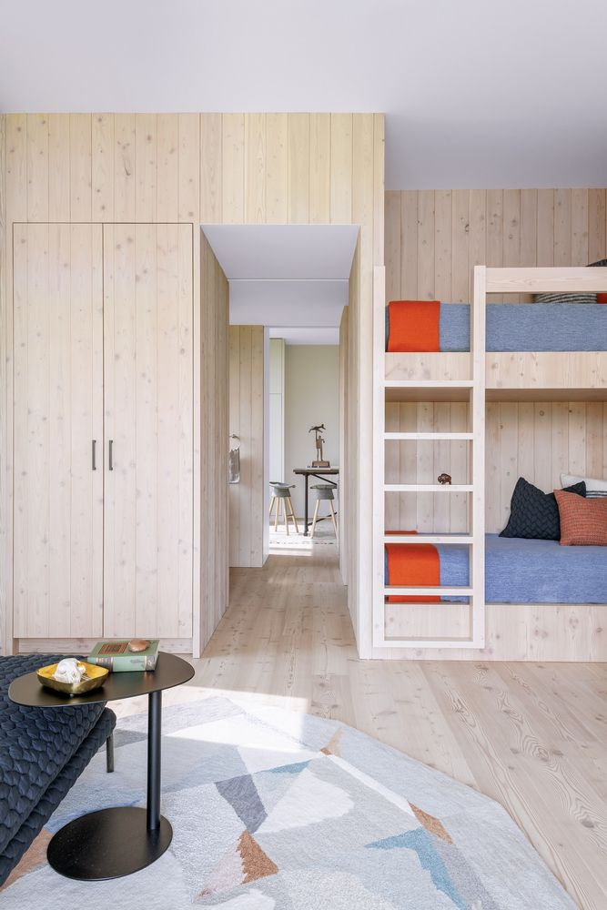 Light wood was used throughout the house in order to maintain an open, airy but also welcoming aesthetic
