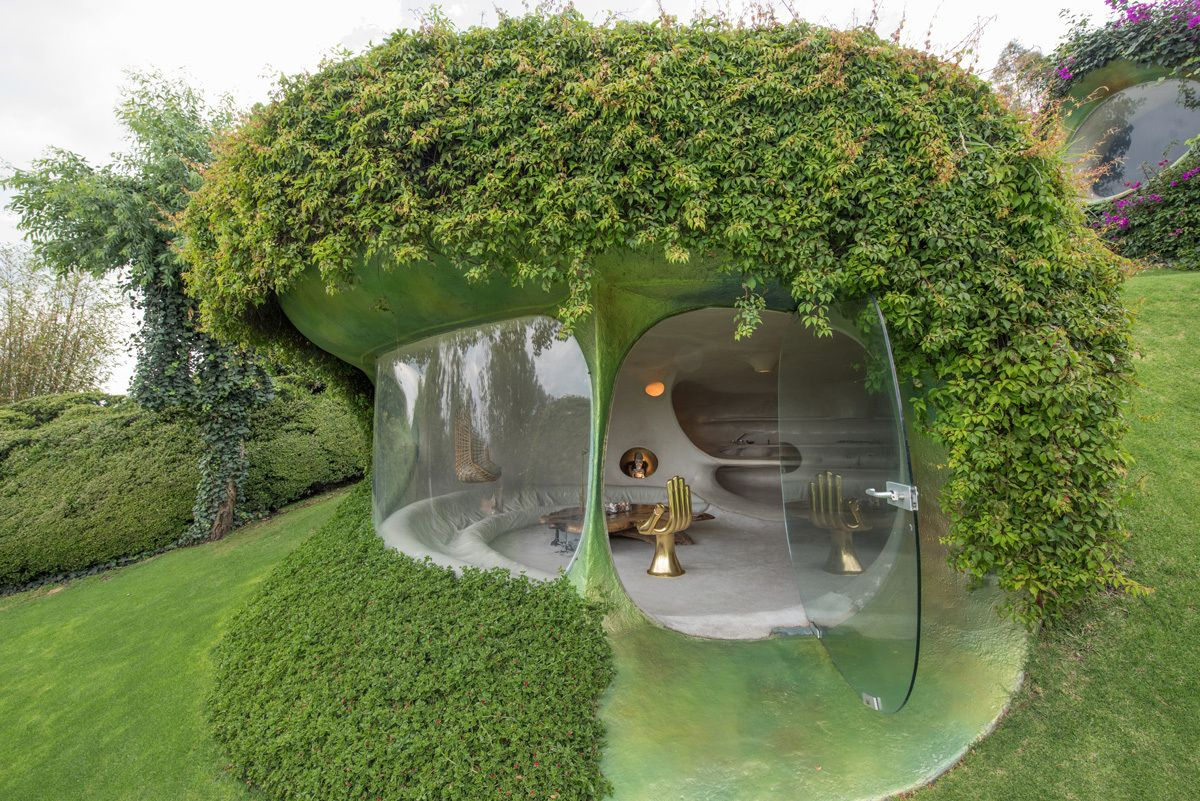One of the window sections is actually a glass door which connects the house to the garden which surrounds it