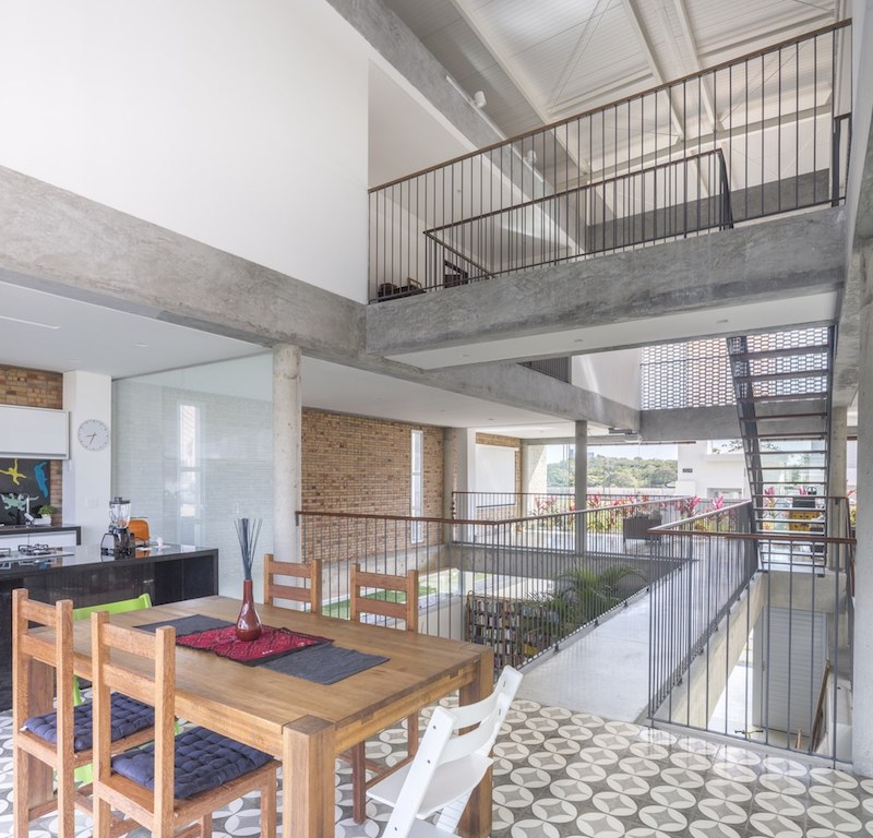 The interior volumes are organized around a central void which integrates the circulation spaces