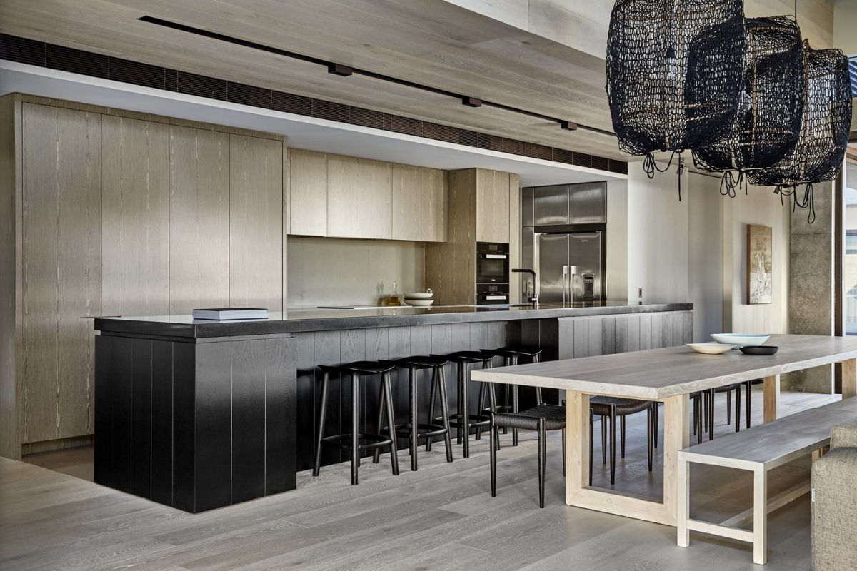 Long and spacious, the kitchen features a dark wooden island.