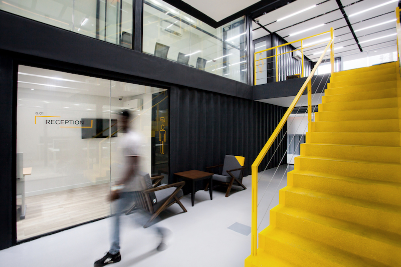 The staircase is yellow, a color that's symbolic for the city the structure is located in