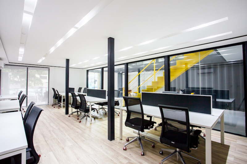 The interior is organized into several areas using glass walls that let the light travel through them