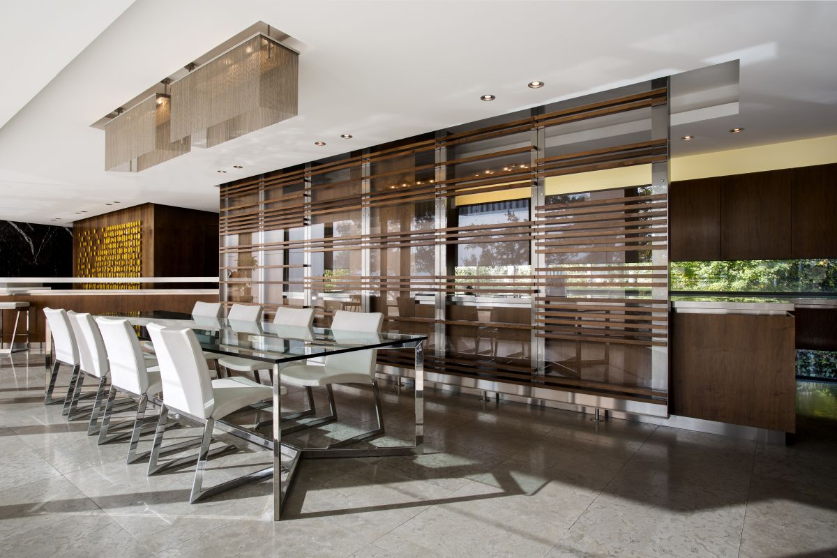The kitchen and dining area are separated by a series of moving wall dividers which can be easily repositioned