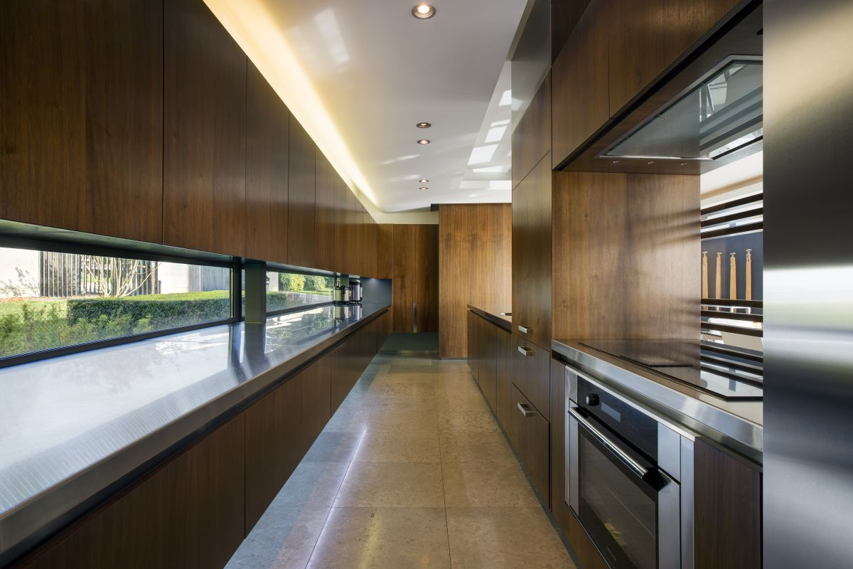The kitchen is spacious and maintains a long and narrow layout with expansive countertops