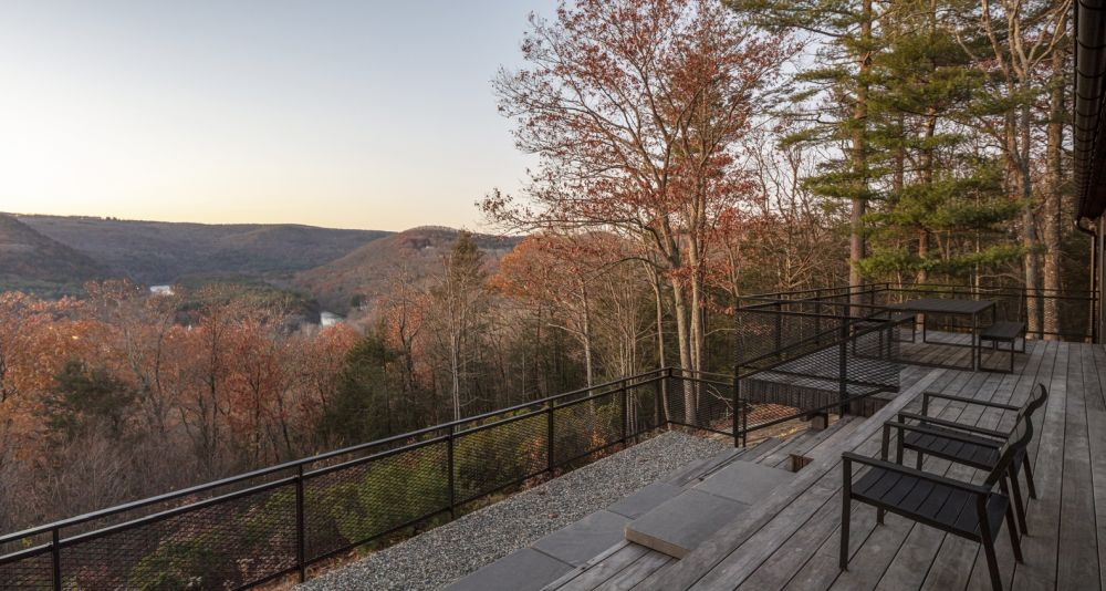 Open terraces and decks take full advantage of the views towards the valley