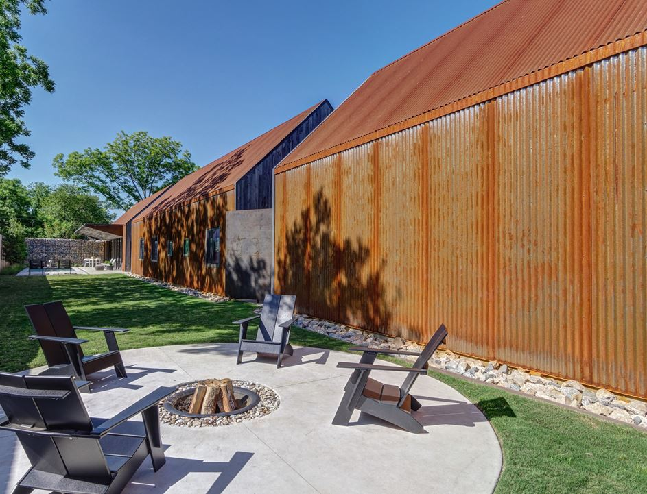 The siding, along with the rock fringe border for drainage, are easy-care choices.