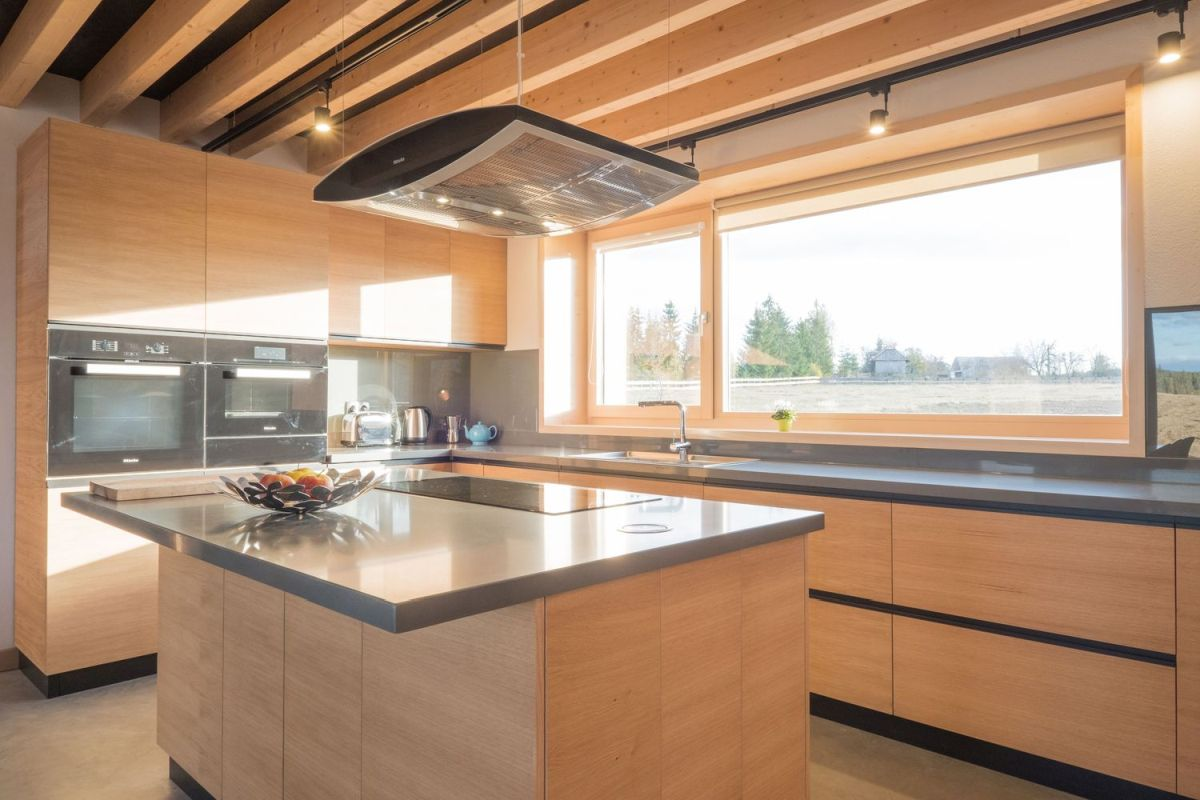 The large kitchen has a great view out of window and maintains a simple and neutral design