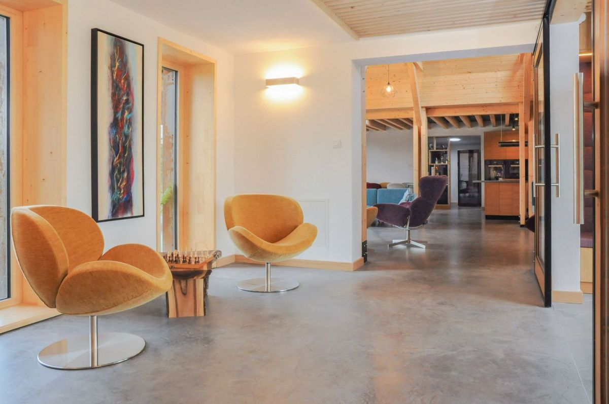 The polished concrete floors connect all the different spaces visually and add cohesiveness to the house