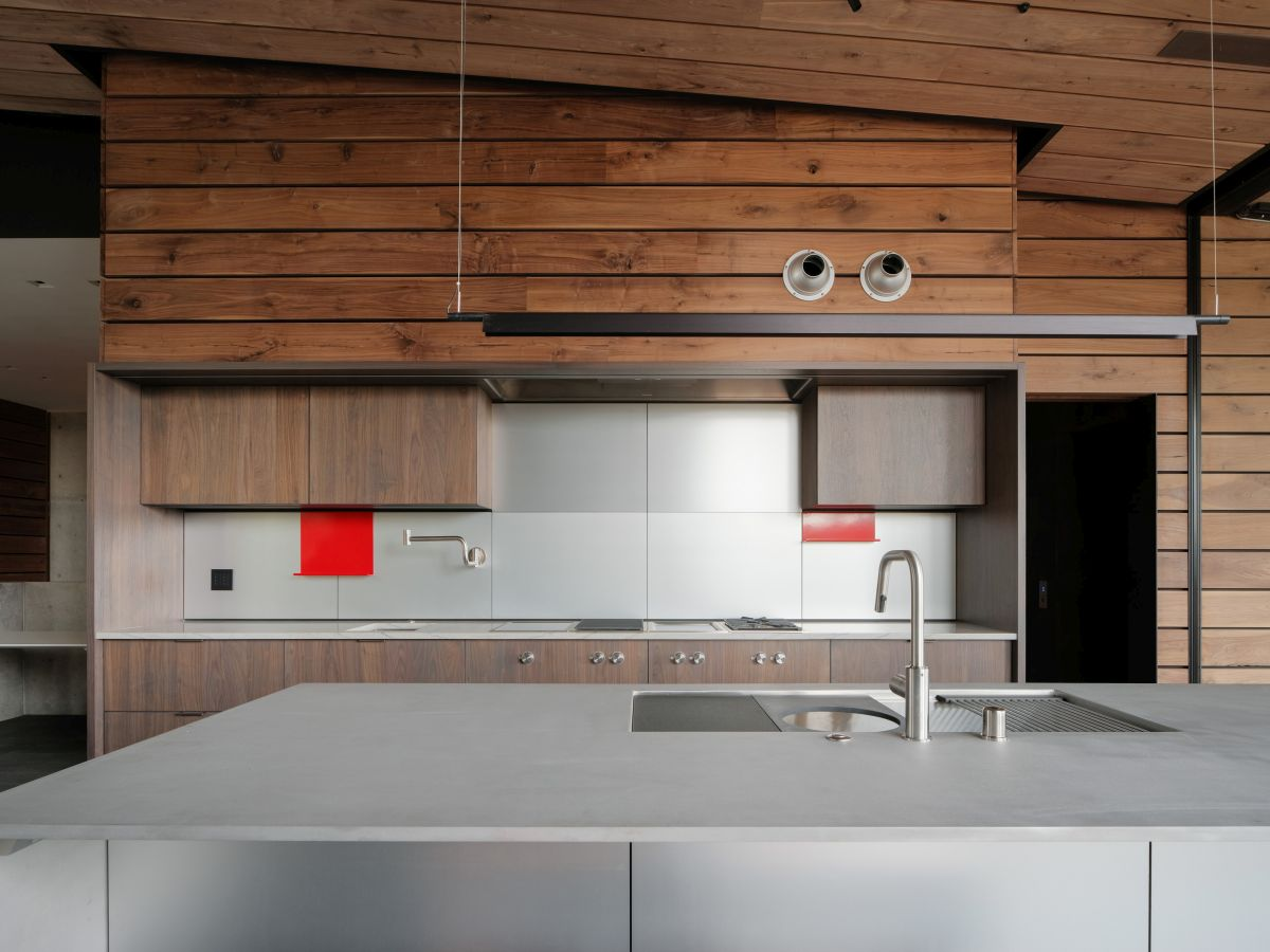 The kitchen has a large island and features wooden accents for added warmth and style