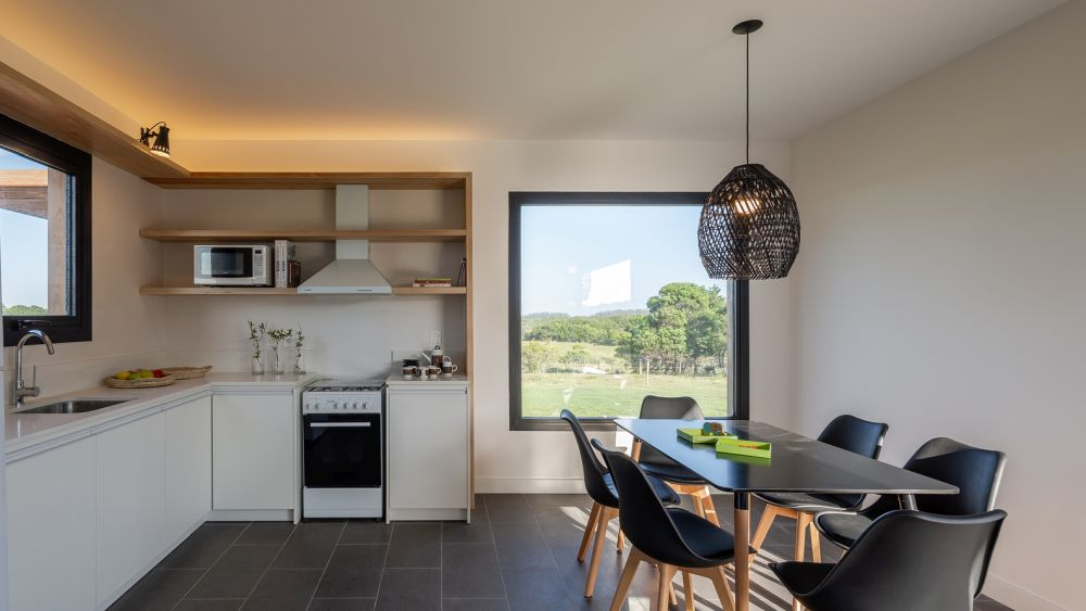 The combined kitchen and dining area have a lovely view and subtle mood lighting