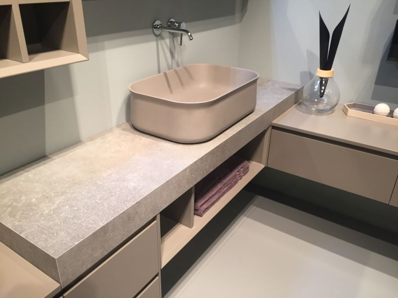 Marble bathroom countertop and storage for towels
