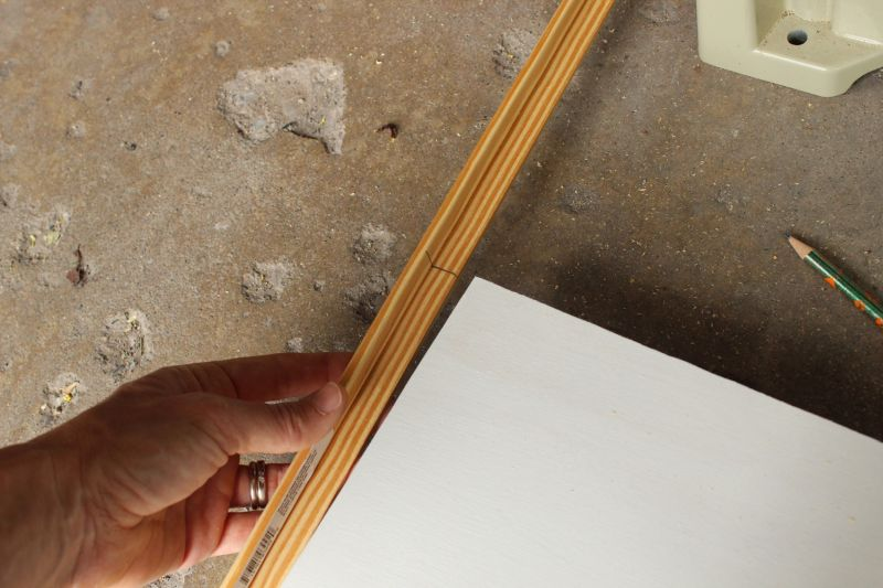 Mark the shelf's width on the end of your trim