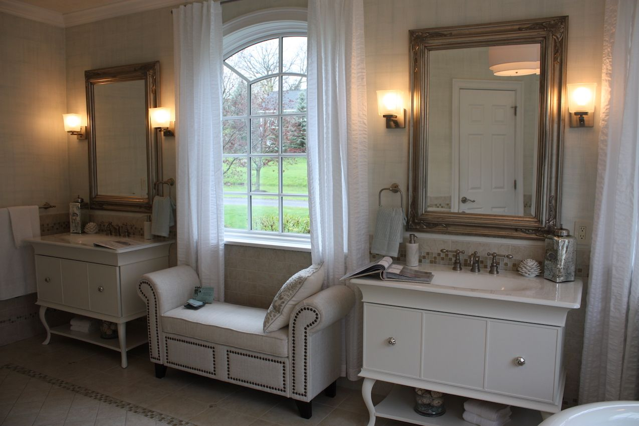 A more modest bench in this bathroom still makes for a comfortable and plush seating option.