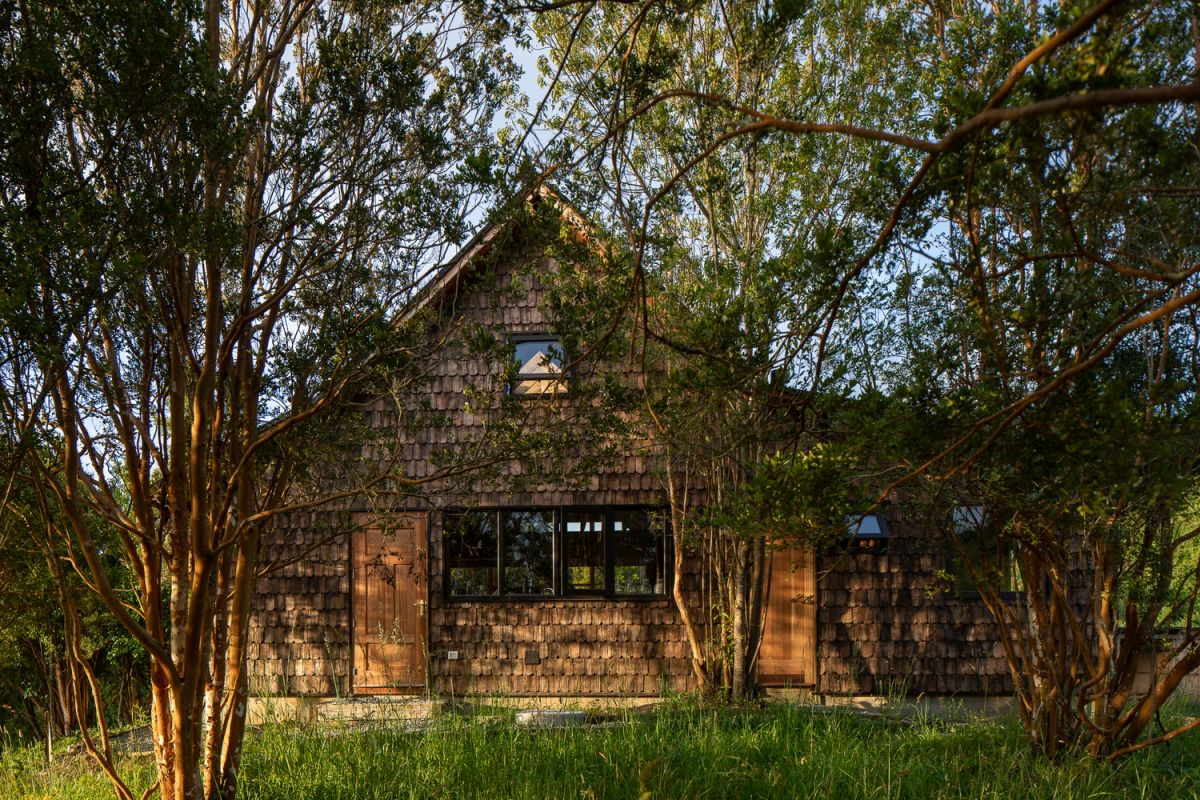 The wooden shingles give the house a traditional appearance which is just what the architects wanted