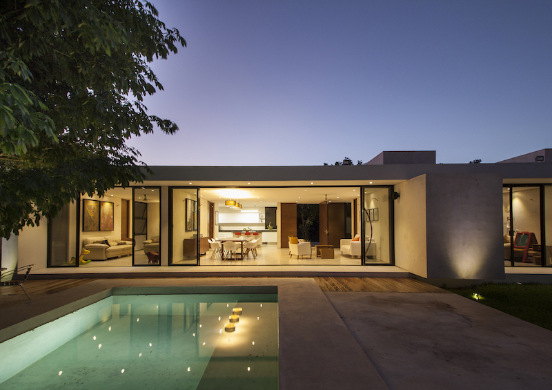 The residence sits on a large site which allows it to have a big backyard with a pool and a lawn