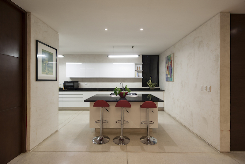 The kitchen, dining area and living room are linked into an open floor plan with access to the pool