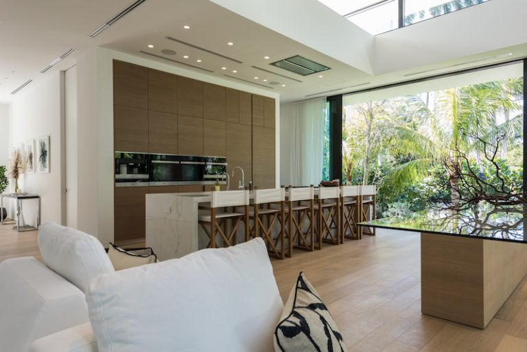 The kitchen is connected to the lounge and dining areas and has a large island that doubles as a bar