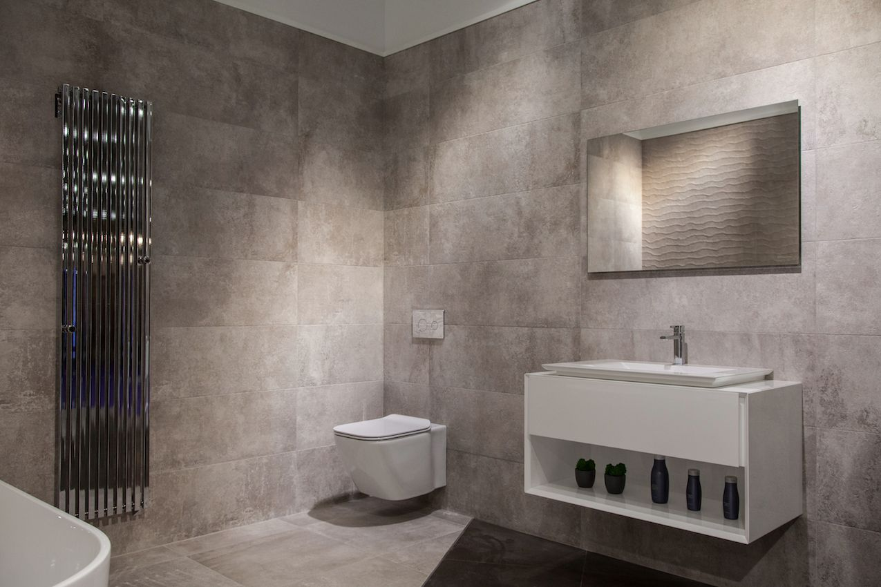 Today's bathroom fixtures are more spare, but have increased functionality and are easy to clean. This minimalist bathroom allows the fixtures to be the focal points of the room.
