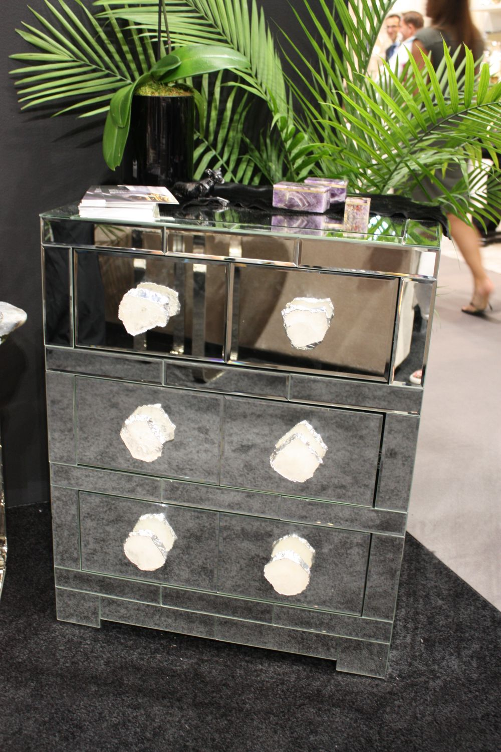Small cabinets with mirrored fronts are big on style and they need little else to stand out